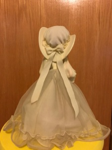 A yellow Bradley Dolls doll hat with bow